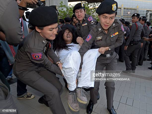 Thai police arrest a student for demonstrating at a shopping mall in Bangkok on May 22 2015 Police arrested several antijunta activists for small...