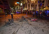 Thai police inspect the scene after a bomb exploded outside a religious shrine in central Bangkok late on August 17 2015 killing at least 10 people...