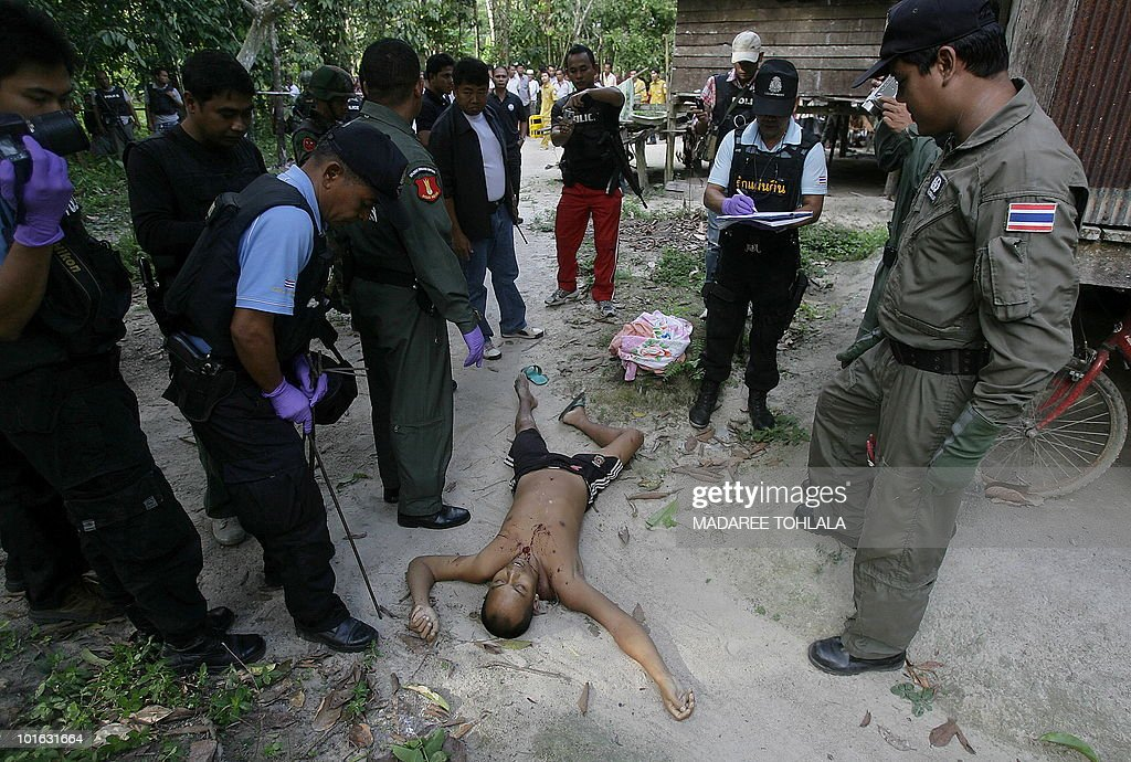 Thai police officers inspect the body of a Muslim man who was shot dead by suspected separatist militants in Thailand's restive southern province of Narathiwat on June 5, 2010. The rebellion across the southern provinces by a shadowy band of separatist Islamists fighting for greater autonomy in the area bordering Malaysia has left more than 4,100 people dead.
