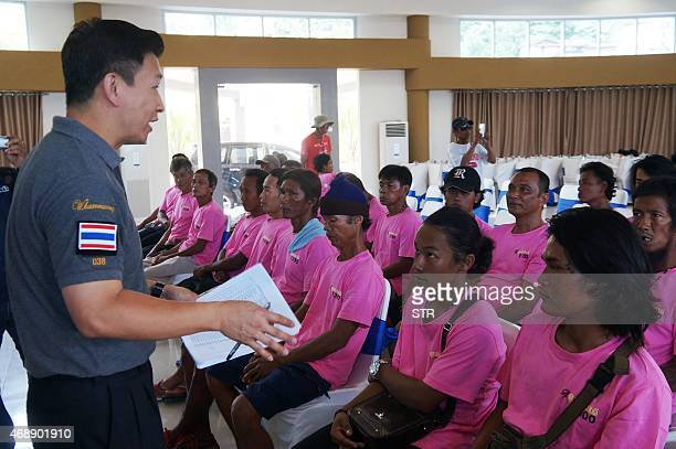 A Thai police official gives a briefing to a group of rescued Thai fishermen on April 8 2015 following their arrival at Ambon fishery port in Maluku...