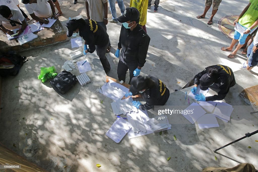 Thai policemen conduct DNA tests on staff from two beachside bars as part of the investigation on the murder of two British tourists on the southern...