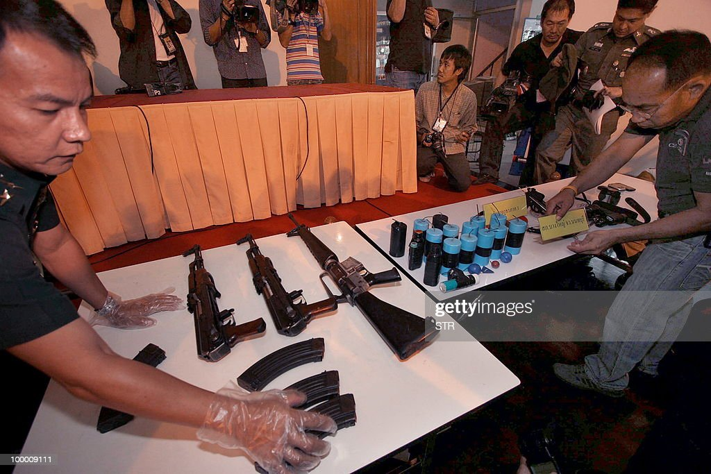 Thai policemen display weapons seized from 'Red Shirt' anti-government protesters at a military base in Bangkok on May 20, 2010. The top Thai protest leader urged supporters of the anti-government 'Red Shirt' movement to refrain from violence after riots in the capital, saying 'democracy cannot be built on revenge.'