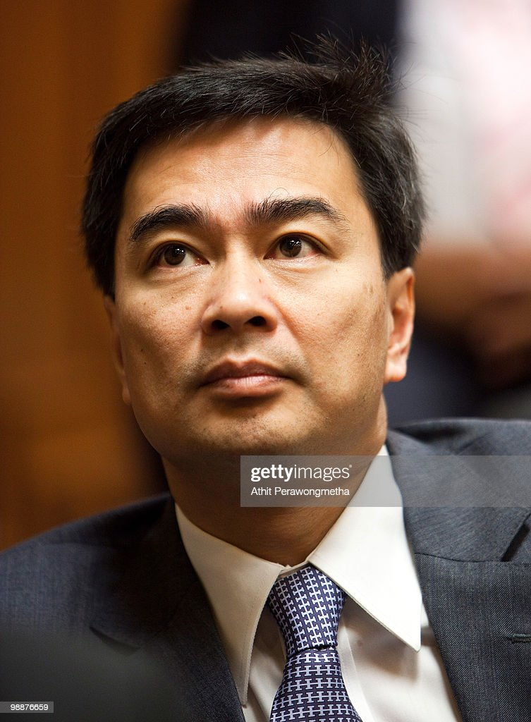Thai Prime Minister <a gi-track='captionPersonalityLinkClicked' href=/galleries/search?phrase=Abhisit+Vejjajiva&family=editorial&specificpeople=645779 ng-click='$event.stopPropagation()'>Abhisit Vejjajiva</a> meets with members of his Democrat party at Parliament on May 6, 2010 in Bangkok, Thailand. Prime Minister <a gi-track='captionPersonalityLinkClicked' href=/galleries/search?phrase=Abhisit+Vejjajiva&family=editorial&specificpeople=645779 ng-click='$event.stopPropagation()'>Abhisit Vejjajiva</a> vows to dissolve Parliament between September 15 and 30 to end Thailand's eight weeks of political crisis. For now the red shirts say they will stay on the streets, continuing the process of negotiations. The anti-government protests that have closed much of central Bangkok's commercial district.