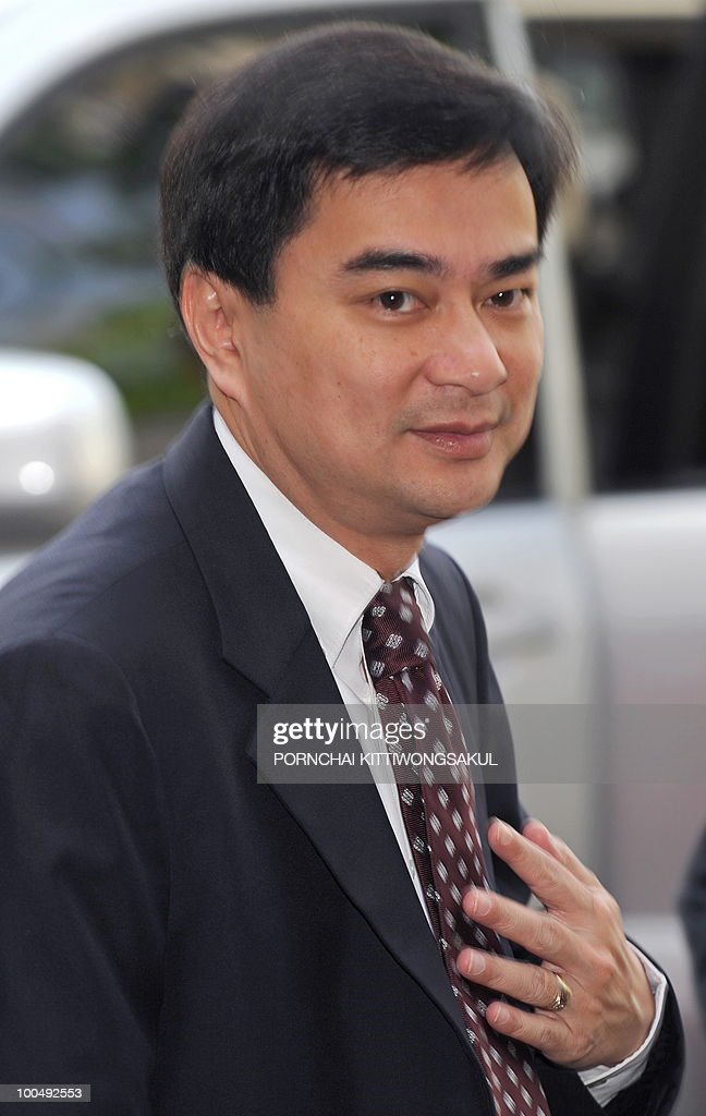Thai Prime Minister Abhisit Vejjajiva smiles as he arrives for weekly cabinet meeting at Government House in Bangkok on May 25, 2010. Thai authorities will ask the government to extend a curfew in Bangkok and 23 provinces for another week in the wake of a crackdown on anti-government protesters, an army official said.