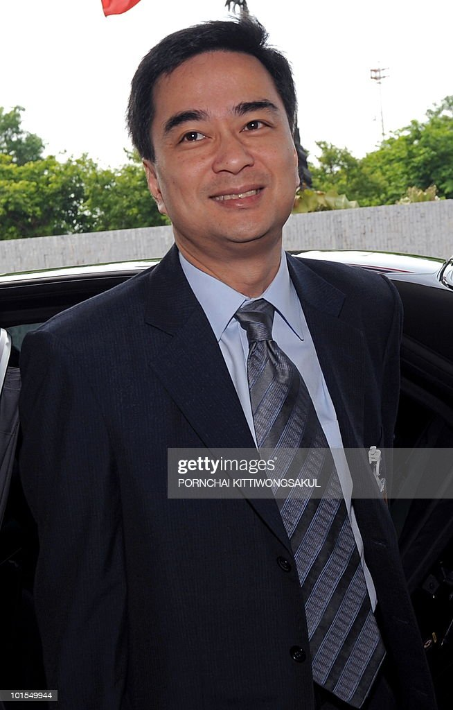Thai Prime Minister Abhisit Vejjajiva smiles prior the no-confidence vote at the parliament in Bangkok on June 2, 2010. Thailand's prime minister easily survived a parliamentary no-confidence vote over his handling of deadly protests by anti-government 'Red Shirts'.