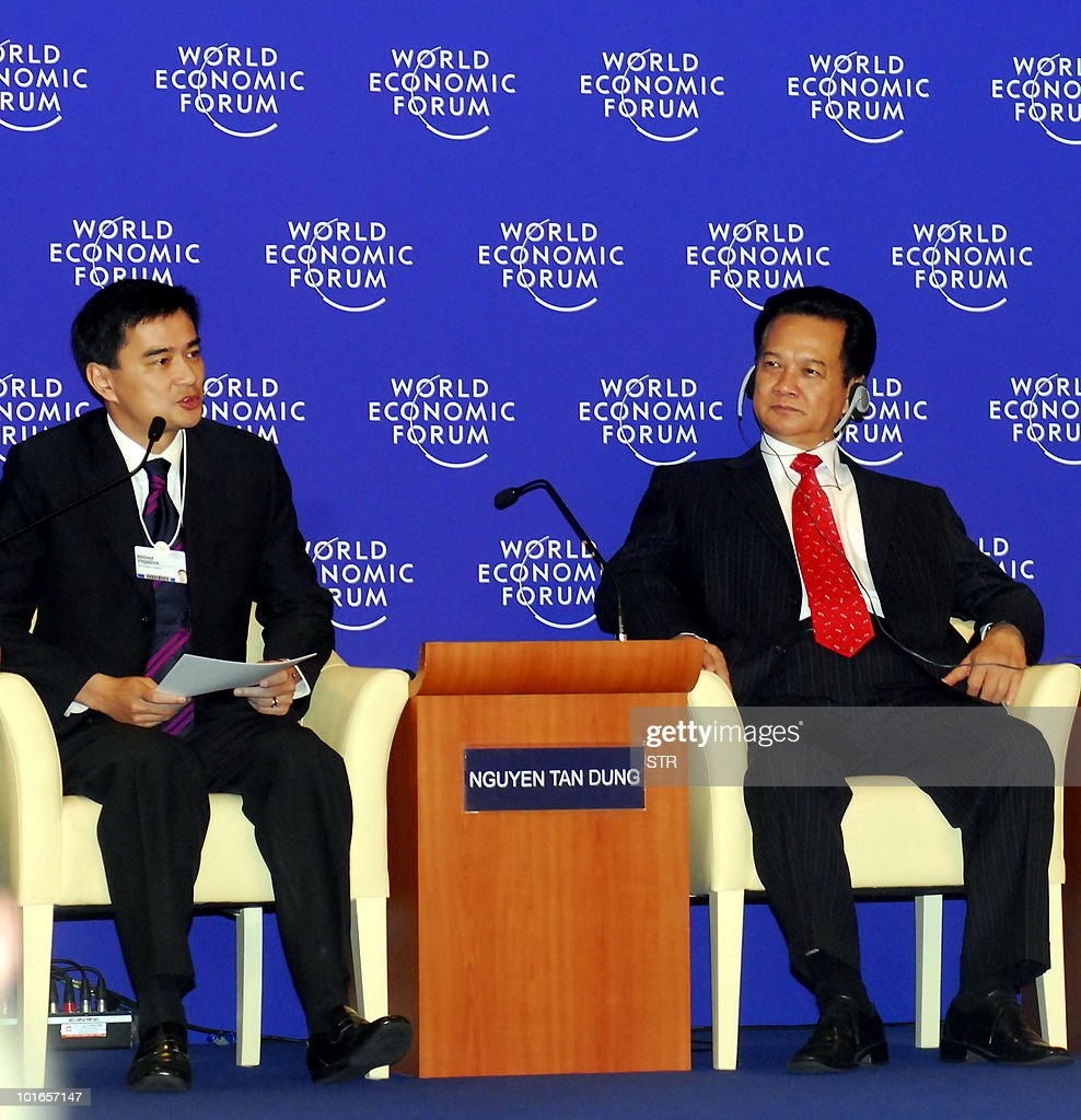 Thai Prime Minister Abhisit Vejjajiva (L) speaks as Vietnamese prime minister Nguyen Tan Dung listens during the World Economic Forum on East Asia being held in Ho Chi Minh City on June 6, 2010. Thailand is 'back' after recent deadly unrest, Thai Premier said on his first trip abroad since the end of crippling anti-government protests. 'We are back, stable and secure,' he told the forum, a gathering of global business leaders and regional politicians.