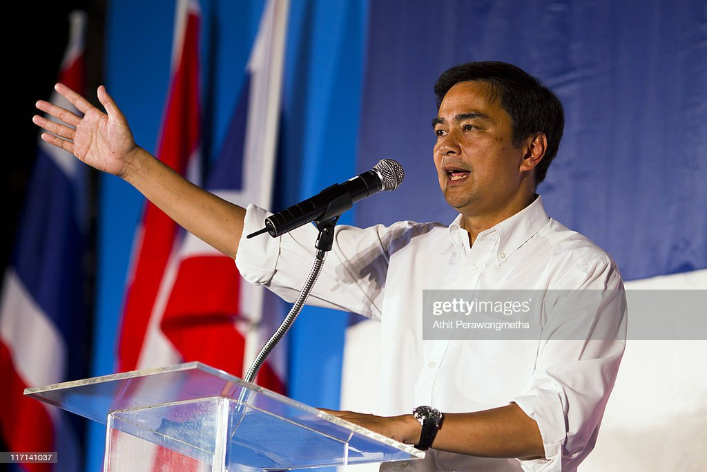 Thai Prime Minister and leader of the Democrat party <a gi-track='captionPersonalityLinkClicked' href=/galleries/search?phrase=Abhisit+Vejjajiva&family=editorial&specificpeople=645779 ng-click='$event.stopPropagation()'>Abhisit Vejjajiva</a> speaks during a rally held at the site of Red Shirt protesters last year on June 23, 2011 in Bangkok, Thailand. Thousands of supporters gathered at Ratchaprasong, Bangkok's prime business and shopping area, to join a major Democrat Party election campaign rally.