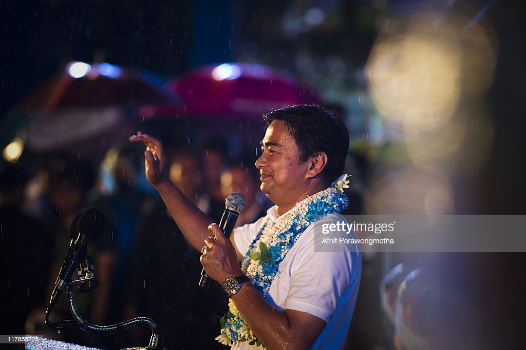 Thai Prime Minister and leader of the Democrat party Abhisit Vejjajiva speaks during a final campaign rally under heavy rain at Royal Plaza on July 1, 2011 in Bangkok, Thailand. Thailand's fourth election in seven years on July 3 will see Prime Minister Abhisit Vejjajiva's Democrats go up against the red shirt movement supported Yingluck Shinawatra, the younger sister of fugitive former prime minister Thaksin Shinawatra, who was ousted in a 2006 coup.
