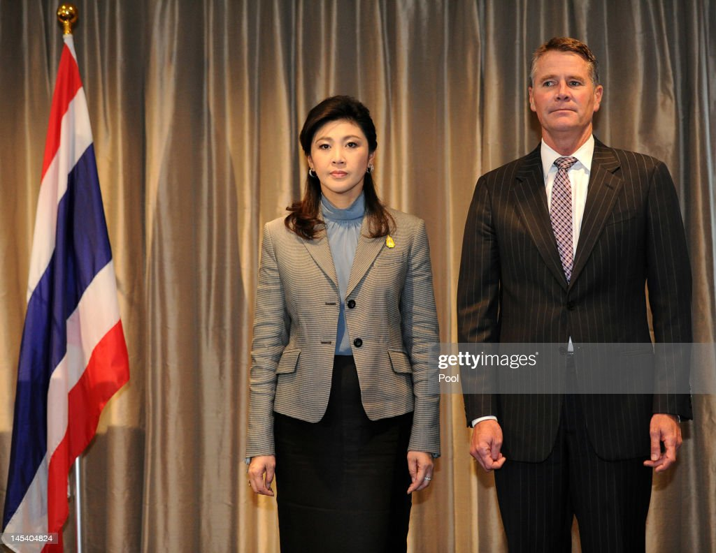 Thai Prime Minister, Ms <a gi-track='captionPersonalityLinkClicked' href=/galleries/search?phrase=Yingluck+Shinawatra&family=editorial&specificpeople=787330 ng-click='$event.stopPropagation()'>Yingluck Shinawatra</a> and Deputy Premier of New South Wales Andrew Stoner, stand for the national anthems during the State Reception held in her honour at Governor Macquarie Tower on May 29, 2012 in Sydney, Australia. Prime Minister Shinawatra is visiting Australia to mark 60 years of diplomatic relation between Thailand and Australia and will hold meetings in Canberra and Sydney to discuss trade and tourism.