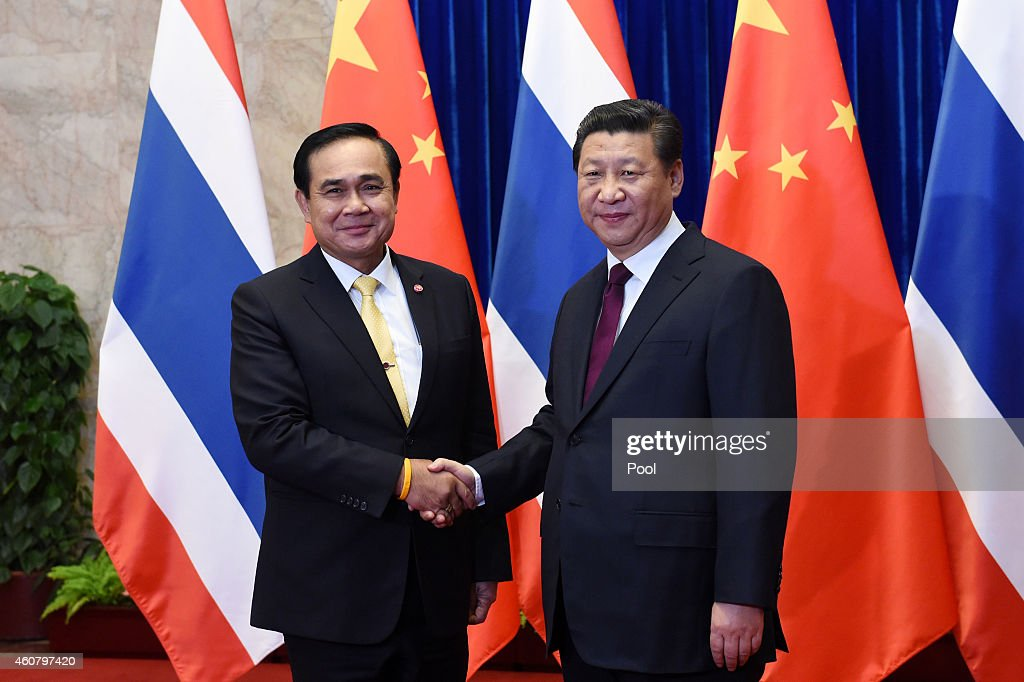 Thai Prime Minister Prayut Chan-o-cha (L) shakes hands with Chinese President <a gi-track='captionPersonalityLinkClicked' href=/galleries/search?phrase=Xi+Jinping&family=editorial&specificpeople=2598986 ng-click='$event.stopPropagation()'>Xi Jinping</a> (R) during a signing ceremony at the Great Hall of the People on December 22, 2014 in Beijing, China. Prayut Chan-o-cha is on a visit to China from December 22 to 23.