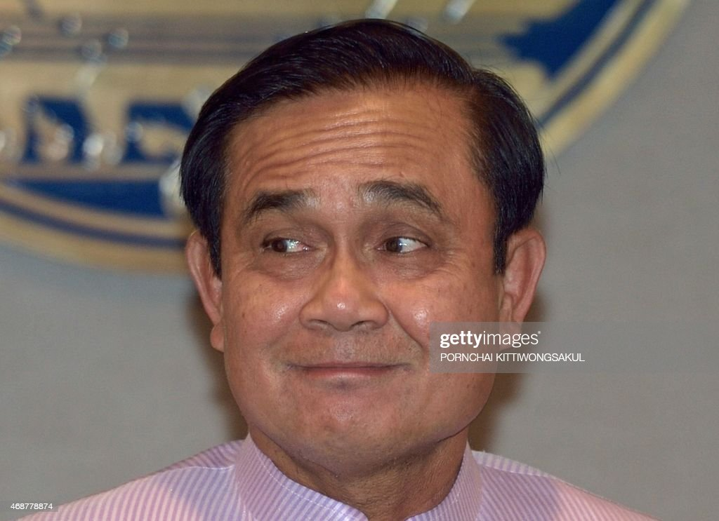 Thai Prime Minister Prayut Chan-O-Cha smiles as he interacts with media following a cabinet meeting at Government House in Bangkok on April 7, 2015. Thailand's junta lifted martial law on April 2 but replaced it with new orders retaining sweeping powers for the military, raising fears the regime is tightening its grip over the kingdom. Special security measures -- including a ban on political gatherings of more than five people -- will continue to blanket the nation, which has seen civil liberties eroded since the army declared martial law and seized power from an elected government last May.