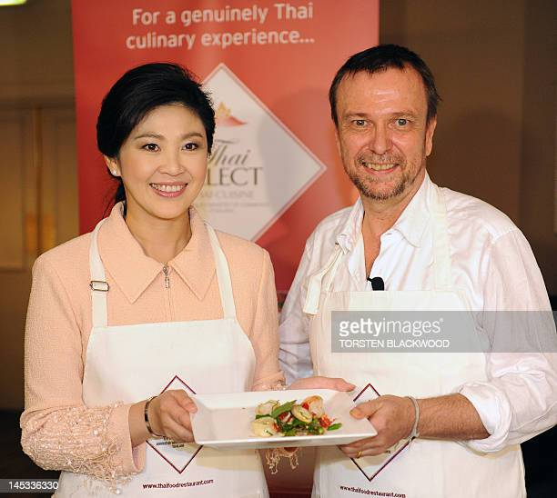 Thai Prime Minister Yingluck Shinawatra and Australian celebrity chef David Thompson present Thai cuisine during the Thai Select Awards in Sydney on...