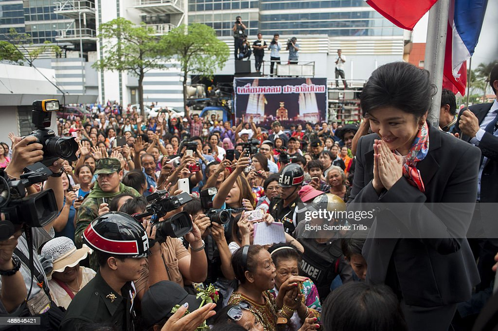 Thai Prime Minister, Yingluck Shinawatra, gives a traditional greeting to her supporters at the Defence Permanent Secretary Office on May 7, 2014 in Bangkok, Thailand. Thai Constitutional Court has ruled that Thai Prime Minister, Yingluck Shinawatra, and 9 cabinet ministers to step down. The charges relate to complaints filed by senators which suggested that Yingluck's party improperly transferred her security chief in 2011.