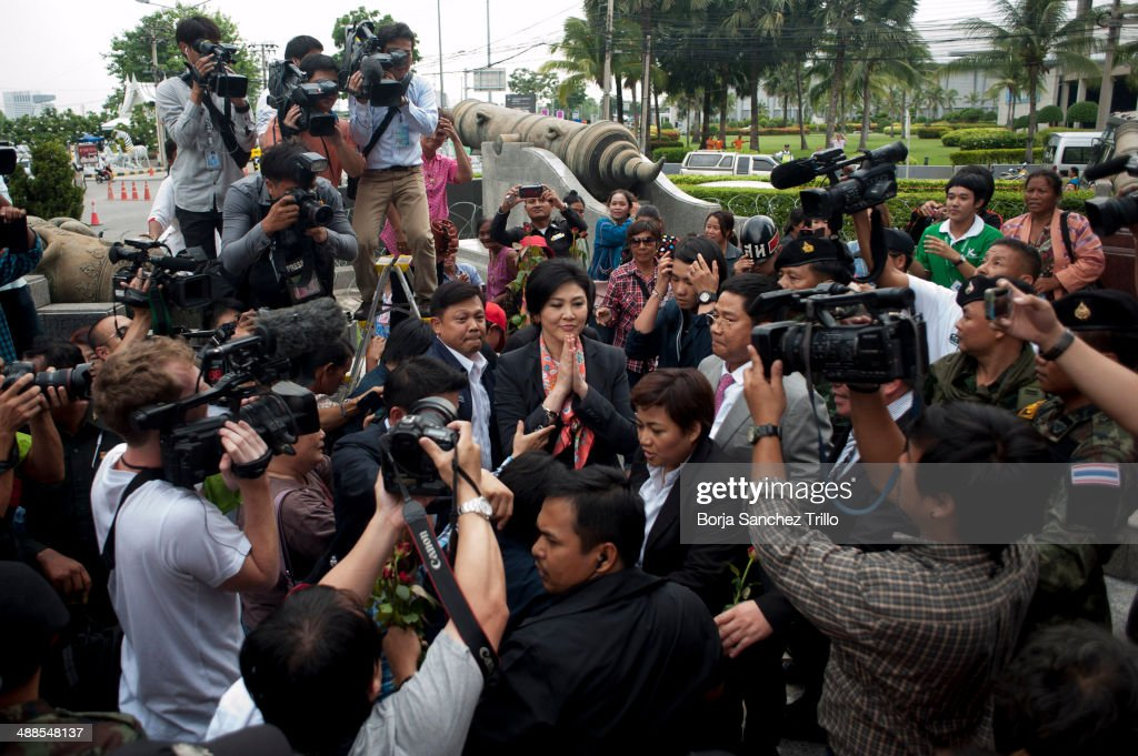 Thai Prime Minister, Yingluck Shinawatra, gives a traditional greeting to her supporters at the Defence Permanent Secretary Office on May 7, 2014 in Bangkok, Thailand. Thai Constitutional Court has ruled that Thai Prime Minister, Yingluck Shinawatra, and 9 cabinet ministers are to step down. The charges relate to complaints filed by senators which suggested that Yingluck's party improperly transferred her security chief in 2011.
