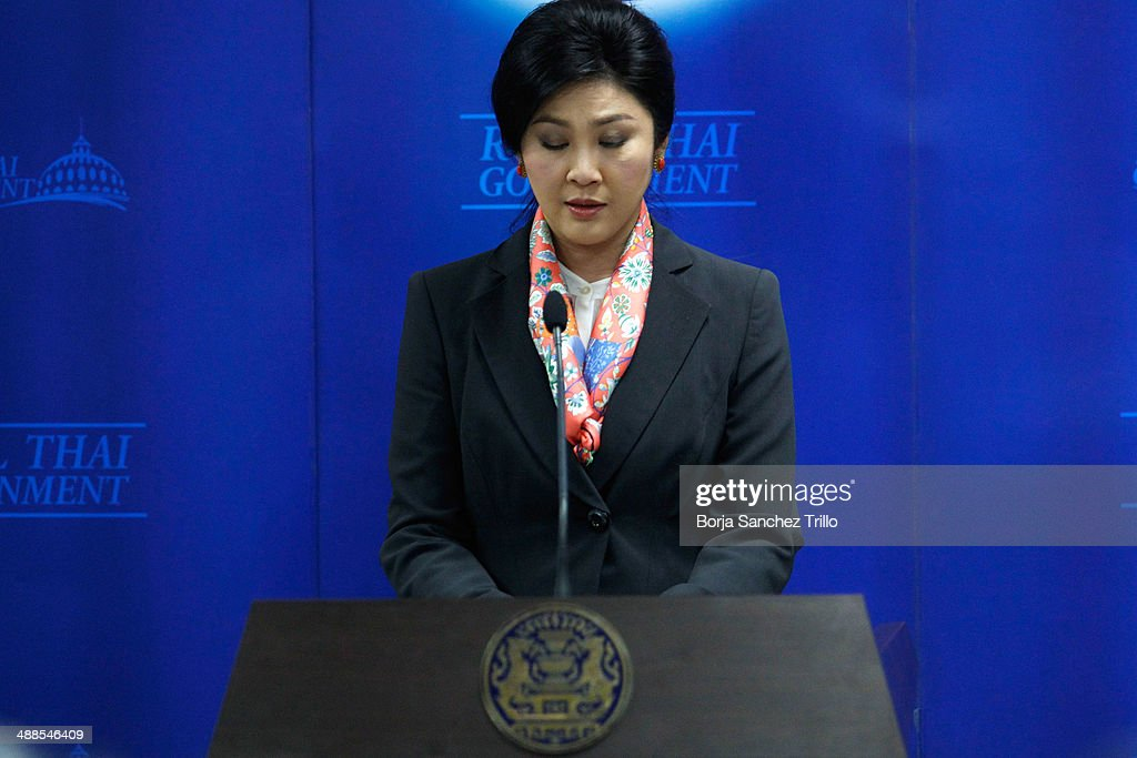 Thai Prime Minister, <a gi-track='captionPersonalityLinkClicked' href=/galleries/search?phrase=Yingluck+Shinawatra&family=editorial&specificpeople=787330 ng-click='$event.stopPropagation()'>Yingluck Shinawatra</a>, listens during a press conference at the Defence Permanent Secretary Office on May 7, 2014 in Bangkok, Thailand. Thai Constitutional Court has ruled that Thai Prime Minister, <a gi-track='captionPersonalityLinkClicked' href=/galleries/search?phrase=Yingluck+Shinawatra&family=editorial&specificpeople=787330 ng-click='$event.stopPropagation()'>Yingluck Shinawatra</a>, and 9 cabinet ministers to step down. The charges relate to complaints filed by senators which suggested that Yingluck's party improperly transferred her security chief in 2011.