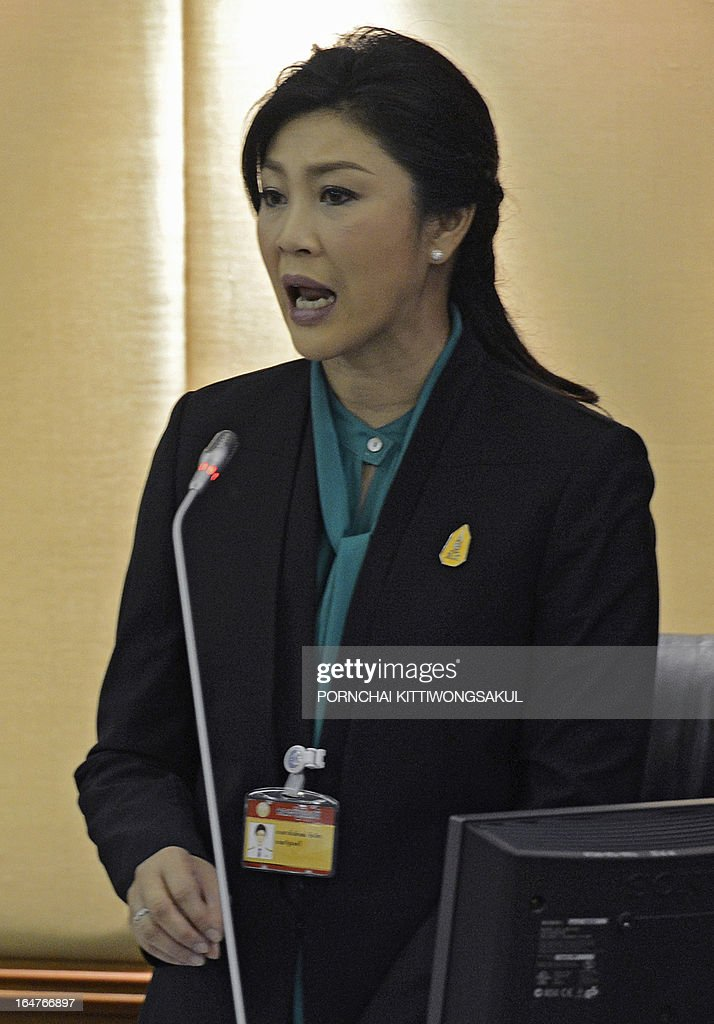 Thai Prime Minister Yingluck Shinawatra speaks during a debate on the 2-trillion-baht loan bill at Parliament, in Bangkok on March 28, 2013. The 2-trillion-baht (USD 68 billion USD) loan bill would be used to boost the national infrastructure and investment projects for the Association of South east Asian Nations Economic Community (AEC).