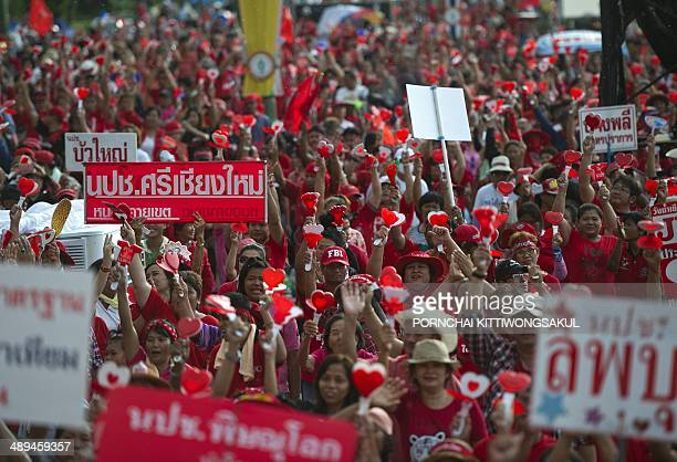 Thai progovernment 'Red Shirts' protesters attend a rally to support the government in Bangkok on May 11 2014 Thousands of progovernment 'Red Shirts'...