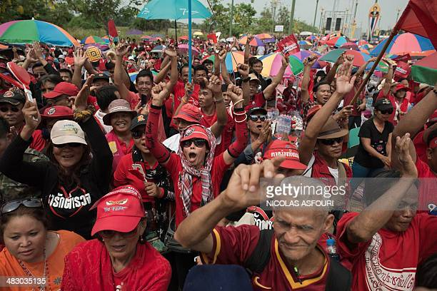 Thai progovernment 'Red Shirts' shout slogans during a rally at Phutthamonthon suburb of Bangkok on April 6 2014 Thousands of Thai progovernment 'Red...