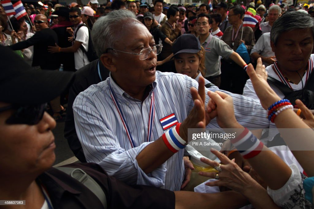 Thai protest leader Suthep Thaugsuban greet his supporters as anti-government protesters march through the streets of Bangkok. More than one million anti-government protesters massed ahead of a major rally aimed at toppling the Prime Minister, paralysing parts of central Bangkok. The Election Commission (EC) has expressed concern over the mass anti-government rallies beginning today, fearing they could prevent the first day of election candidate registration on Monday. The Democrat Party said it would boycott February's general election, deepening a political crisis as protesters called for another major rally to step up efforts to oust the government and force political reforms.