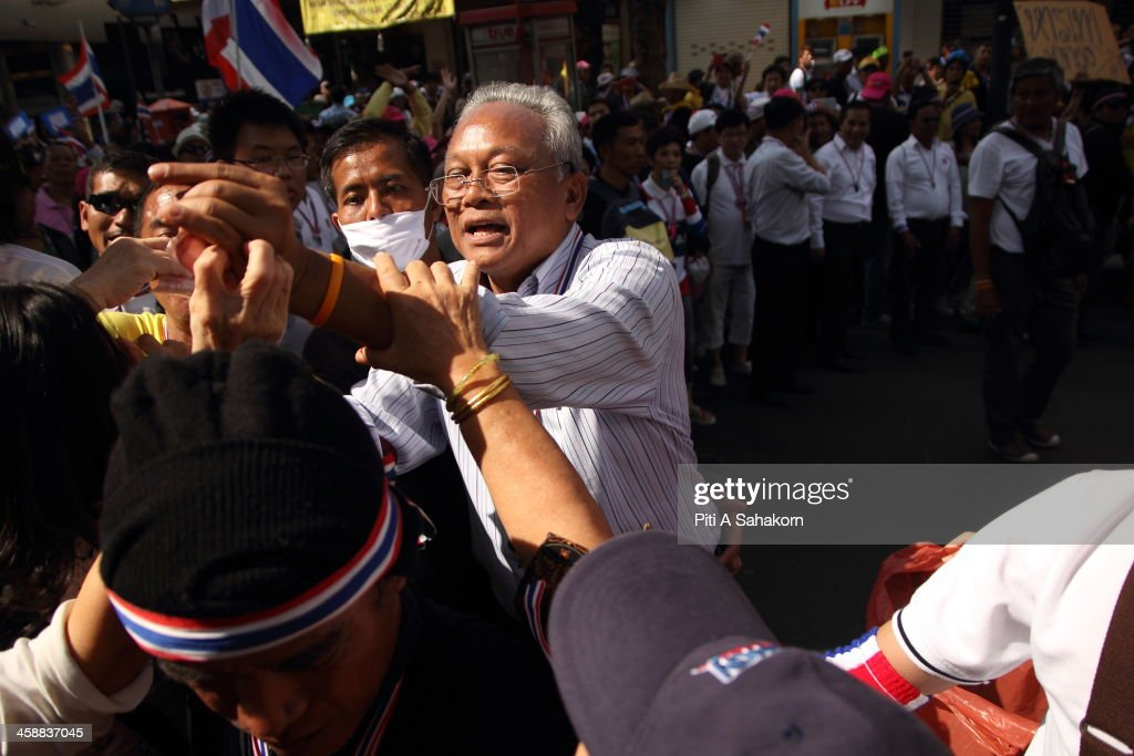 Thai protest leader Suthep Thaugsuban receives bank notes from supporters as anti-government protesters march through the streets of Bangkok. More than one million anti-government protesters massed ahead of a major rally aimed at toppling the Prime Minister, paralysing parts of central Bangkok. The Election Commission (EC) has expressed concern over the mass anti-government rallies beginning today, fearing they could prevent the first day of election candidate registration on Monday. The Democrat Party said it would boycott February's general election, deepening a political crisis as protesters called for another major rally to step up efforts to oust the government and force political reforms.