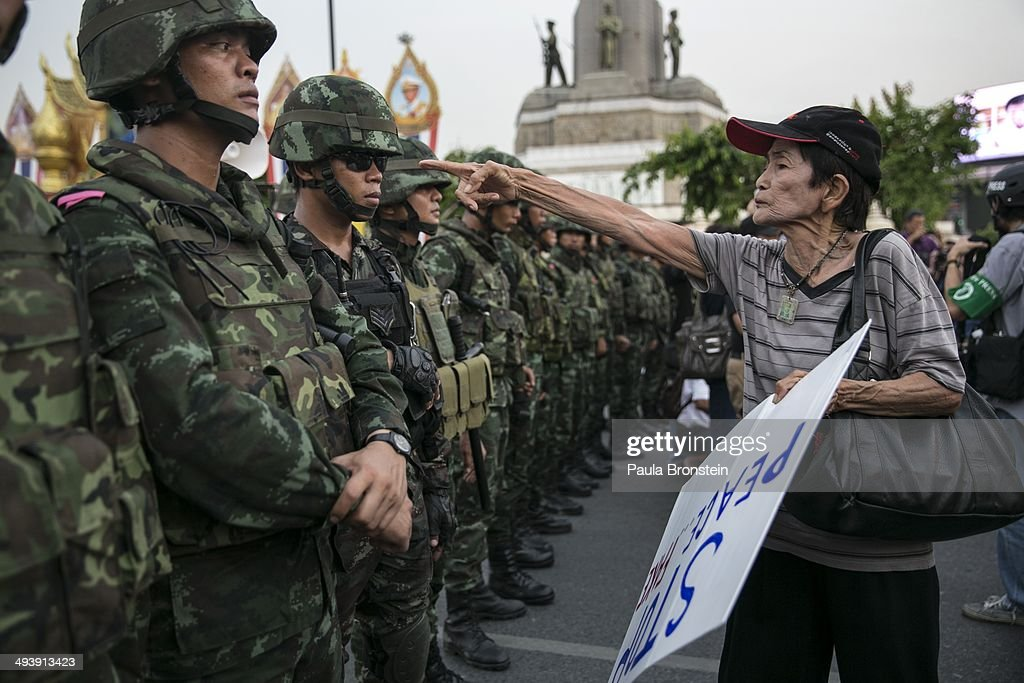 A Thai protester points a finger at the Thai military during an anti-coup protests as General Prayuth receives the Royal Endorsement as the military coup leader May 26, 2014 in Bangkok, Thailand. Thailand has seen many months of political unrest and violence which has claimed at least 28 lives. Thailand is known as a country with a very unstable political record, it is now experiencing it's 12th coup with 7 attempted pervious coups. Thailand's coup leaders have detained former Prime Minister Yingluck Shinawatra, along with Cabinet members and other anti-government protest leaders for up to a week.