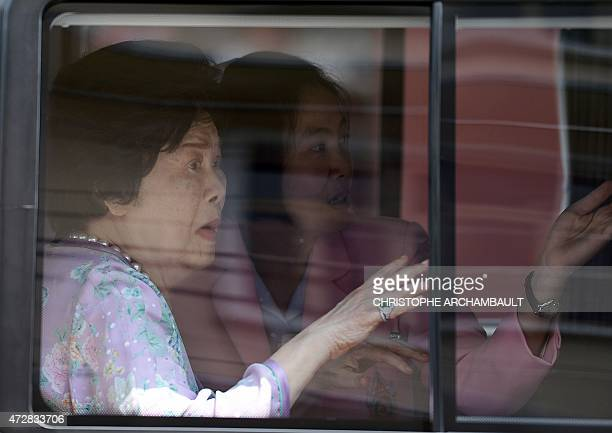 Thai Queen Sirikit sits in her car as she leaves the Siriraj hospital in Bangkok on her way to the coastal palace in the southern city of Hua Hin on...