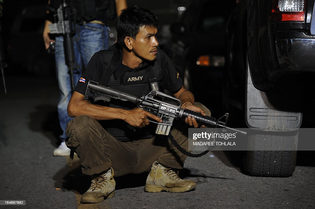 A Thai Ranger holds his rifle during a clash with suspected separatist militants in Thailand's restive southern province of Narathiwat late on March 26, 2013. Thailand and a key rebel group operating in the insurgency-wracked south are set to begin landmark peace talks on March 28 aimed at curbing violence that has killed more than 5,500 people in nine years. AFP PHOTO/Madaree TOHLALA