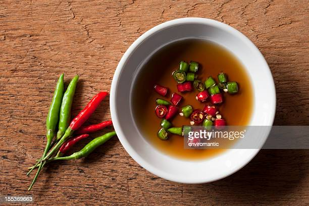 Thai red and green chili in bowl of fish sauce.