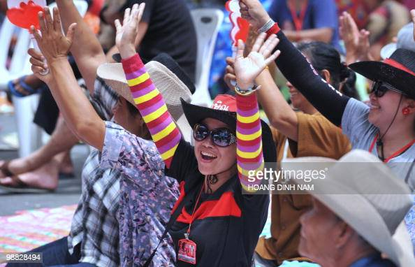 Thai 'Red Shirt' antigovernment protester raise their arms during a rally inside their fortified camp in the financial central district of Silom in...