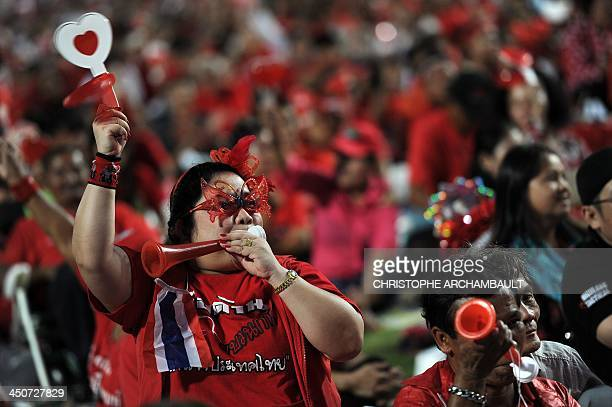 Thai Red Shirts supporters react to a leader's speech during a rally at a stadium in Bangkok on November 20 2013 Thailand's ruling party on November...