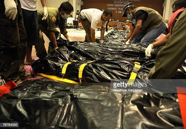 Thai rescue team pack body bags containing victims from plane crash victims at Phuket International Airport on September 17 2007 in Phuket Thailand A...
