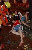 Thai rescue workers help the injured after a bomb exploded outside a religious shrine in central Bangkok late on August 17 2015 killing at least 10...