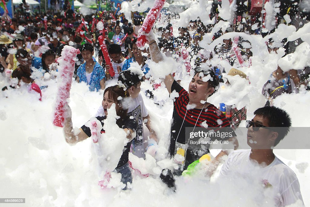 Thai revellers dance during the Songkran water festival in a foam party on April 13, 2014 in Bangkok, Thailand. The Songkran festival marks the traditional Thai New Year and is celebrated each year from April 13 to 15. The throwing of water originated as a way to pay respect to people and is meant as a symbol of cleansing and purification.