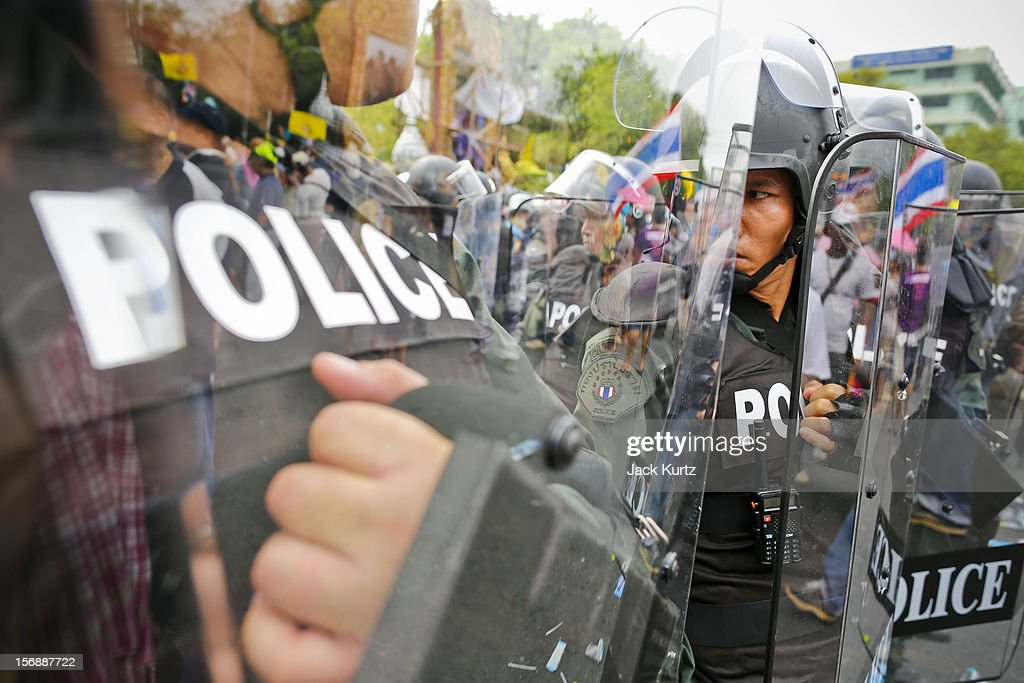 Thai riot police deploy against anti-government protesters during a large anti government protest on November 24, 2012 in Bangkok, Thailand. The Siam Pitak group, which sponsored the protest, cited alleged government corruption and anti-monarchist elements within the ruling party as grounds for the protest. Police used tear gas and baton charges againt protesters.