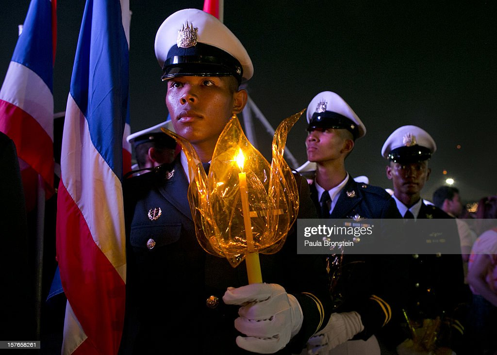 Thai royal military hold candles during celebrations to pay respect to Thailand's King Bhumibol Adulyadej on his 85th birthday December 5, 2012 in Bangkok, Thailand. King Bhumibol took the throne in 1946, making him the world's longest reigning monarch and the world's longest serving head of state. Yellow represents Monday, the birthday of the King.