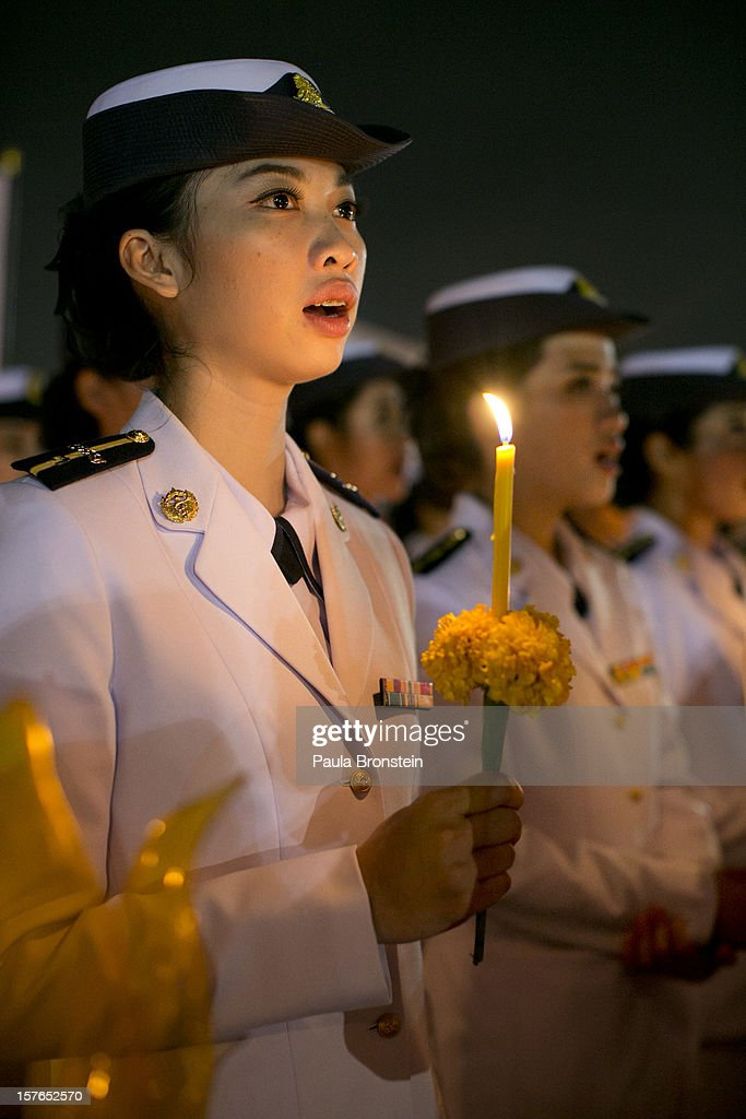Thai royal nurses hold candles during celebrations to pay respect to Thailand's King Bhumibol Adulyadej on his 85th birthday December 5, 2012 in Bangkok, Thailand. King Bhumibol took the throne in 1946, making him the world's longest reigning monarch and the world's longest serving head of state. Yellow represents Monday, the birthday of the King.