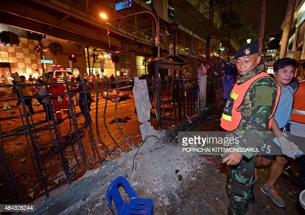 A Thai soldier looks at the damage after a bomb exploded outside a religious shrine in central Bangkok late on August 17 2015 killing at least 10...