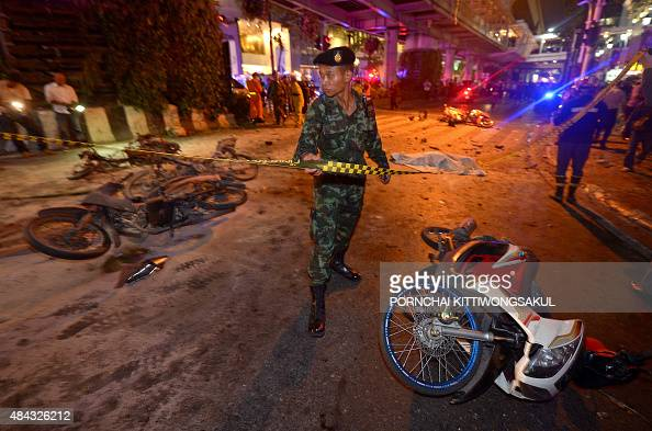 A Thai soldier ropes off the scene after a bomb exploded outside a religious shrine in central Bangkok late on August 17 2015 killing at least 10...