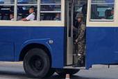 Thai soldier stands guard on a school bus in Thailand's restive southern province of Narathiwat on January 3 2014 Stuttering peace talks to end...