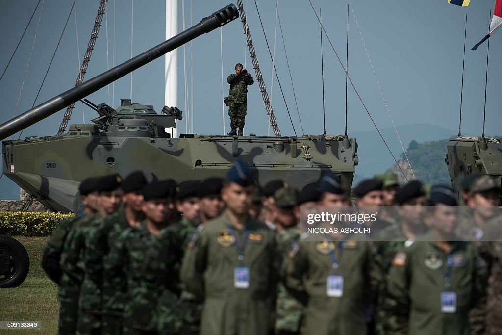 A Thai soldier (top C) takes a photo from the top of an armoured vehicle during the opening ceremony for the annual Cobra Gold 2016 military exercises in Sattahip on February 9, 2016. Thailand and the US jointly host Cobra Gold, Asia's largest military exercise, from February 9 to 20. AFP PHOTO / Nicolas ASFOURI / AFP / NICOLAS ASFOURI