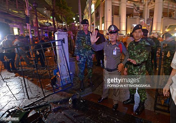 Thai soldiers and police stand guard after a bomb exploded outside a religious shrine in central Bangkok late on August 17 2015 killing at least 10...