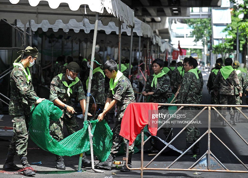 Thai soldiers clear debris on anti-government protesters' tents at the main protest area in Bangkok on May 21, 2010. Thailand picked up the pieces after violence and mayhem triggered by a crackdown on anti-government protests, as the focus swung to recovery and reconciliation in a divided nation.