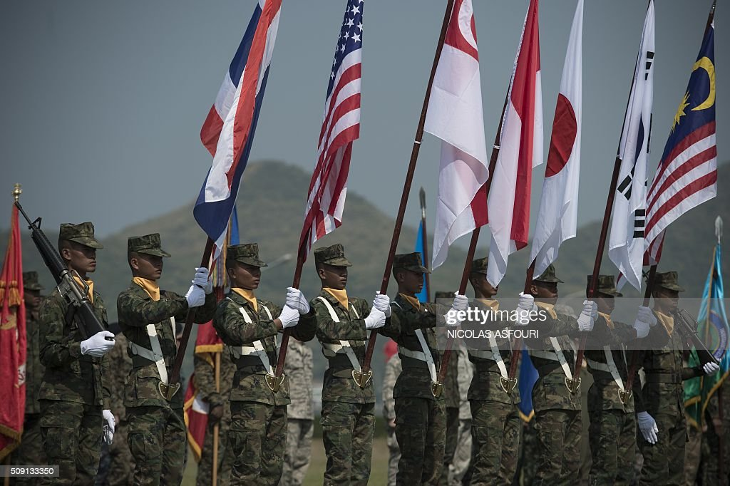 Thai soldiers hold the flags of participating countries during the opening ceremony of the annual Cobra Gold 2016 military exercises in Sattahip on February 9, 2016. Thailand and the US jointly host Cobra Gold, Asia's largest military exercise, from February 9 to 20. AFP PHOTO / Nicolas ASFOURI / AFP / NICOLAS ASFOURI