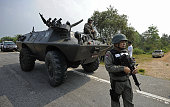 Thai soldiers in an armoured vehicle secure the area after the killing of a Ranger shot dead by suspected Muslim separatist militants in Thailand's...