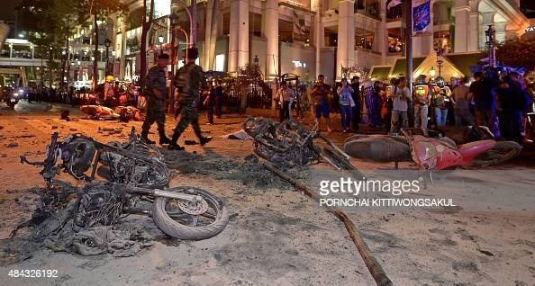 Thai soldiers inspect the scene after a bomb exploded outside a religious shrine in central Bangkok late on August 17 2015 killing at least 10 people...