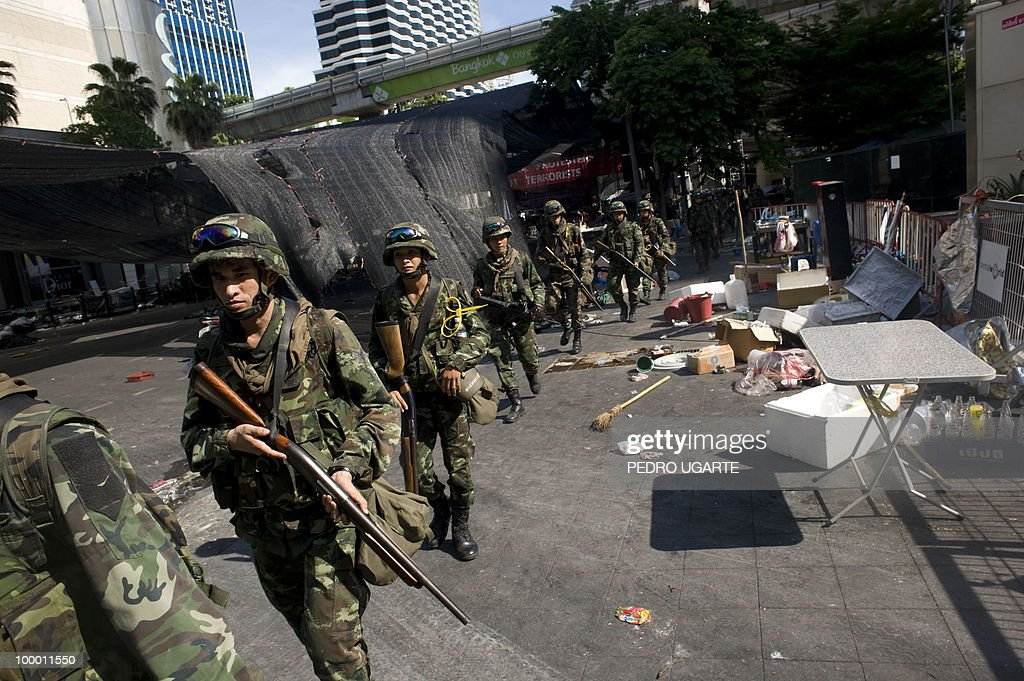Thai soldiers patrol the area used as the main stage of the Red Shirt anti-government protesters in the comercial center of Bangkok on May 20, 2010. Thai troops hunted down militants who went on a rampage of arson and looting in Bangkok, after an army crackdown on their anti-government protest camp that ended two months of street rallies.