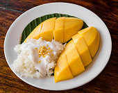 Thai style tropical dessert, glutinous rice eat with mangoes
