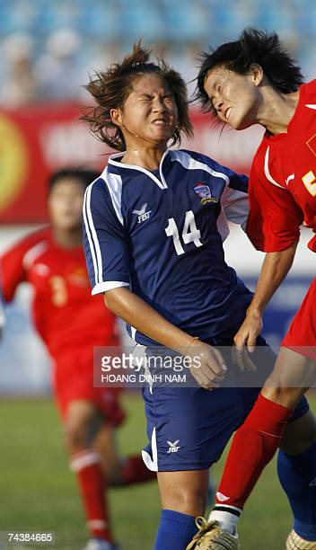Thai Sukunya Peangthem fights for the ball with Vietnamese Nguyen Thi Mai Lan during a Beijing Olympics 2008 qualifying women's soccer match at Hai...