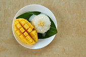 Thai style tropical dessert, glutinous rice eat with mango