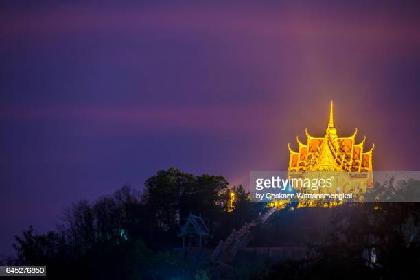 Thai Temple on top of the mountain with colorful sky.